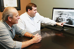 Prosthodontist Dr. William Roe is a specialist dentist in tooth replacement and restoration.